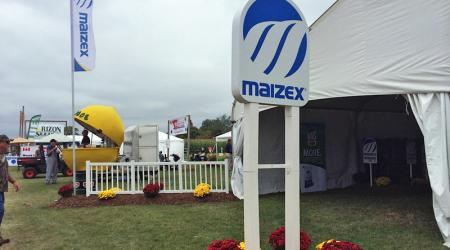 Maizex sign in front of tent at Canada's Outdoor Farm Show