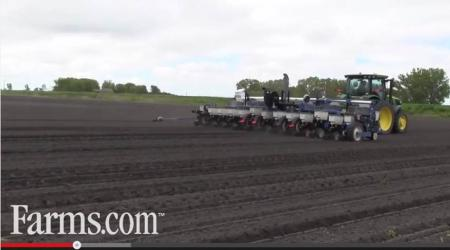 Tractor pulling a planter through the field